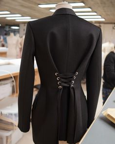"""Alexander McQueen on Instagram: """"In the London atelier: a single-breasted tailored jacket with dropped shoulders, wide lapels and laced silver metal eyelets at the back. …"""" Tailored Jacket, Single Breasted, Alexander Mcqueen, Blazer, London, Jackets, Lapels, Silver Metal, Dresses"""