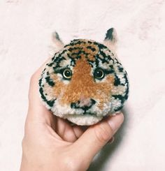 Look At These Amazing Animal Pom-Poms | Top Crochet Pattern Blog. This is really stunning!