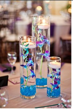 Centerpiece with floating candles. Can put purple stones at the bottom for more of a purple feel