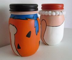 Hand-Painted Fred and Wilma Flintstone Inspired Mason Jar Piggy Banks, set of pint-sized - Paint is protected with 2 coats of Clear, Matte Varnish. Such cute shelf décor for any kids room or nursery Mason Jar Art, Mason Jar Crafts, Painted Jars, Hand Painted, Fred And Wilma Flintstone, Craft Storage, Storage Ideas, Diys, Diy Crafts For Gifts