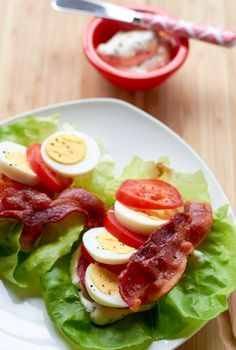 Low Carb BLT -sans bun with our lettuce wrap version which encases savory bacon in a refreshing blanket of lettuce and tomatoes. A smear of lemon aioli escalates lettuce wraps to another level. Serve with a hardboiled egg for more calories and protein. Low Carb Lunch, High Protein Low Carb, Low Carb Diet, Low Calorie Meals, Carb Free Lunch, Cholesterol Diet, Low Carb Recipes, Diet Recipes, Cooking Recipes