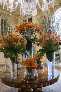 Orange Lilies, Alstroemeria, Celosia and Pin Cushions balanced by Curly Willow give this week's arrangement at The Plaza Hotel a rustic but vibrant Autumn look. Large Flowers, Pretty Flowers, Wedding Stage Decorations, Table Decorations, Hotel Flower Arrangements, Jeff Leatham, Hotel Flowers, Corporate Flowers, Orange House