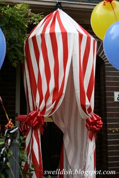 """Need big circle (ie hula hoop or larger) red & white stripe cloth & red ribbon """"big top"""" entrance"""