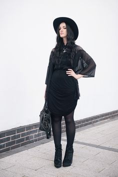 Fashion blogger Stephanie Brown of FAIIINT wearing Catarzi fedora, Pins & Needles at Urban Outfitters lace kimono, AllSaints Shirt, Religion draped skirt, Bloody Mary Metal Luna Tribe Luna Love necklace, Kurt Geiger ponyhair wedge boots, Balenciaga city. Dark street style, all black witchy outfit.