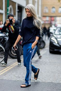 This is how you style your trackies! Vogue's Sarah Harris was still backing Team Athleisure outside the Marques' Almeida SS17 show at LFW with a snug navy roll-neck, classic blue adidas joggers and super-casj sliders for the win