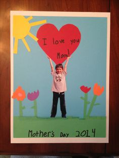Mother's Day idea. What mom doesn't want a cute cut-out of her kid holding a heart? My first graders cut out all the pieces, and I helped with the gluing. Attach ribbon on the back (using hot glue) so that it can be hung year round! :)