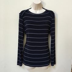 NWOT Chico's Nautical Travelers Top Lovely blue travelers top with white stripes. Long sleeves and a folded scoop neckline. Made of 90% acetate 5% viscose 5% spandex. Perfect for travel as its wrinkle resistant. Chico's size 0 which is there extra small. Chico's Tops Tees - Long Sleeve