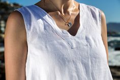 Linen Peasant dress. Made for that everlasting feel of summer and youthfulness. This is perhaps the most fitting selection if you are buying your first item of linen clothing. This is a sleeveless loose-fitting dress with inseam pockets. The silhouette is crisp and clean.  French peasant dress. Flax plant. Cape Town. Africa. Women Fashion. Natural clothing. Freedom. Linen clothing. Flax Plant, Natural Clothing, Out Of Style, Cape Town, Clothing Items, Crisp, Going Out, Tank Man, Freedom