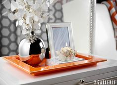 Trays are an inviting option to organize accessories. For a sophisticated look with a pop of personality, artfully arrange your decorative finds atop a boldly hued tray.