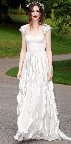 Look of the Day › July 7, 2011 WHAT SHE WORE Hathaway dressed the part at The White Fairy Tale Love Ball in an embellished Valentino Garavani gown and crystal Stephen Jones wreath.