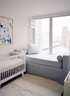 A Cool, Modern Nursery with a Seriously Good Art Collection | Macrame Wool Rug via Serena & Lily | Image via Style Me Pretty