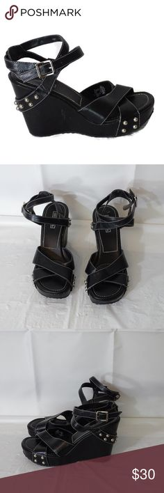 """Harley-Davidson Sandals Size 8M Black Studded ITEM DESCRIPTION:  Harley-Davidson Studded Platform Wedge Sandals  Details:  4"""" heel  Women Size:  8M  Color: Black  Pattern: solid  Closure: Buckles on side  Fabric:  Faux Leather  Made in:  China  ITEM CONDITION:  Pre-owned …There are some marks and scuffs. There is a red mark under the sole of the shoe.  There is one spot where the material has peeled just a little (see the last picture). Harley-Davidson Shoes Sandals"""