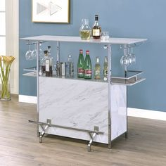 Rianna white finish faux marble bar table with wine racks and foot rest. This set features multiple shelves with wine rack storage area and glass holder racks. Bar table measures 47 x 22 x H. Bar Furniture For Sale, Online Furniture, Wine Rack Storage, Wine Racks, Cabinets For Sale, Bar Cabinets, Contemporary Bar, Metal Bar, Modern Spaces
