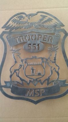 Custom Michigan Police badge with your number and city on Etsy, $110.00