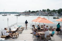 Catch a quiet moment on one of Rocktide Inn's beautiful harborside decks overlooking Boothbay Harbor, Maine.