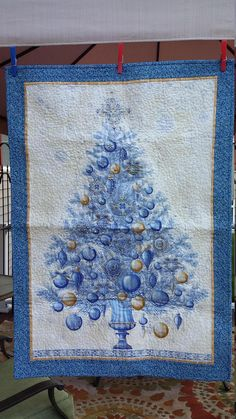 One of a kind handmade quilted Christmas tree wallhanging in blue, silver, and gold with metallic sparkle.  4 Options Available:  Quilted only $95 Quilted and beading $110 Quilted and lights $110 Quilted,beading, and lights $125  After you choose your option I will make it for you to order. Allow up to 3 weeks to complete. I will convo you with coordinating fabrics for the flange, border and binding. (Quilt in pictures is in the process of being beaded and will have lights) If you choose…