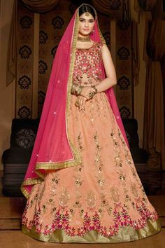 Peach silk semi stictch lehenga with raw silk choli. This lehenga choli is embellished with resham, zari, stone and embroidered .Product are available in 40 sizes. It is perfect for Festival Wear,Wedding Wear,Party Wear,New Year. http://www.andaazfashion.com/womens/lehenga-choli/newarrival