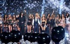 (L-R) Hozier, Taylor Swift, Ed Sheeran and Ariana Grande with Victoria's Secret models on the runway during the 2014 Victoria's Secret Fashion Show at Earl's Court Exhibition Centre on December 2, 2014 in London, England.