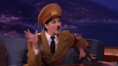 A very sexy Hitler, portrayed by Jewish comedian Sarah Silverman, distanced himself from presidential candidate Donald Trump during an appearance on Conan. The Führer took issue with comparisons to the Donald made by Louis C.K. in the Daily News.  http://l7world.com/2016/03/hitler-disavows-trump-conan.html