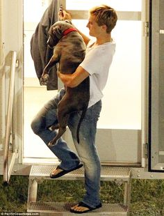 Puppy love: Josh Hutcherson was seen lifting his pet pooch Driver down the steps of his trailer on the set of The Hunger Games: Catching Fire in Atlanta Georgia yesterday.  I think I love him.