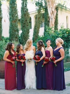 Bride smiling with rich colored, fuchsia bridesmaids.  - Melissa Jill Photography