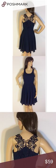 ALTAR'D STATE GORGEOUS NAVY DRESS Beautiful dress that's a fit and flare style with a side zip and a beautiful crochet detail back. Altar'd State Dresses