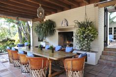 Covered patio with saltillo tile, Mexican equipale seating, long dining table…