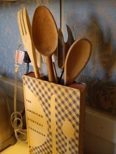 UTENSIL HOLDER MADE With Vintage Books - a vintage cookbook can hold everyday utensils and add kitschy flair to your kitchen
