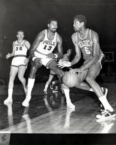 Wilt Chamberlain, NBA basketball player for the Philadelphia 76ers, tries to stop Bill Russell of the Boston Celtics. (John W. Mosley. Circa 1960s)