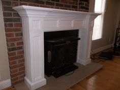 Painted white custom fireplace mantle surround