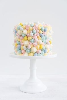 Impress all your Easter guests with this three-tiered carrot cake that's finished with pretty pastel cream cheese frosting. #recipe #food #ideas #easter #holiday #dessert #inspiration