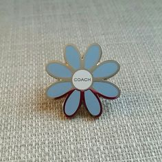Authentic Coach Blue Enamel Daisy Pin Gorgeous pin makes a great gift! Features nickel hardware and blue enamel. Only marks are from normal store handling only. Coach Jewelry Brooches