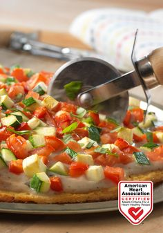 Pizza Primavera with Cauliflower Crust — Here's a tasty twist on traditional pizza that is so good it's sure to become a pizza night favorite! Heart-Check Certification does not apply to recipes or information reached through links unless expressly stated.