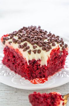 Red Velvet Poke Cake with Cream Cheese Frosting - If you like red velvet, you're going to LOVE this EASY cake!! Super soft, moist, topped with luscious cream cheese frosting and chocolate chips! Perfect for holidays and special events!!