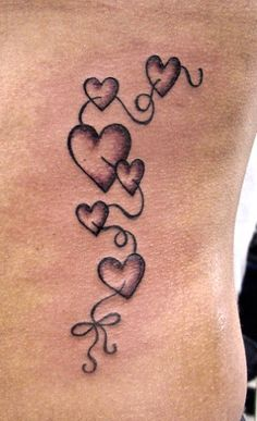 heart tattoo...one for each of my babies (I need to have a few more babies :) )