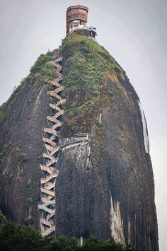 Looks like the rock is stitched together. 659 steps to the top: The Guatape Rock in Colombia.... you'd certainly find out who your real friends were!!!!!