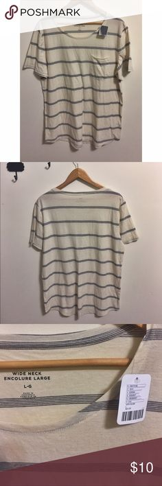 NWT Urban Outfitters Striped Tee Shirt Cream colored short sleeve tee shirt with blue stripes. Has a pocket for detail. Wide neck. Never worn or used. Very soft material 60% cotton and 40% polyester. No stains or damage - my phone just makes a weird shadow on the shirt in 3rd pic. Offers and questions welcomed 😊😊. BDG Shirts Tees - Short Sleeve