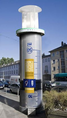 """""""There's no better medicine for the environment than your contribution"""" says this Greenpeace advertisement, where the pillar was turned into a giant medical syringe"""