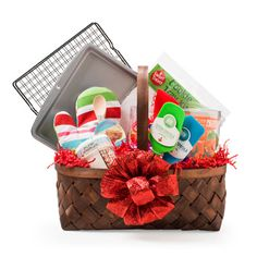 Cookie Baker Gift Basket - Treat your favorite cookie connoisseur to a basket full of essential cookie baking and decorating supplies. Choose a large woven basket along with wire cooling racks, a cookie sheet, silicone coated spatulas, a printed oven mitt, 104-piece cookie cutter set, holiday sprinkles and a cookie tray wrapping kit!