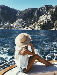 ♕pinterest/amymckeown5 Blonde beach babe with a fedora hat, looking at the rocks on her yacht !