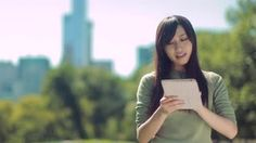 2a0321173654d Young Asian Woman walking using tablet pc computer Stock Video Footage - Storyblocks  Video