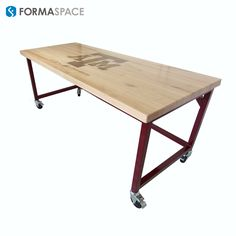 Texas A&M Logo Inlayed in Desk | FORMASPACE | Formaspace added customized finishes to this Basix with mobility, a maple top with a walnut inlay, and maroon powder coated steel for Texas A&M.
