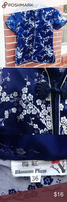 """Beautiful traditional Asian top For my petite cuties.  Gorgeous shimmery blue 100% silk Asian top with silver flowers. Approx 23"""" long and 17"""" wide.  There is very small amount of stitching that has come undone where collar meets shirt (last pic) not noticeable.  Wish this fit me😀 Tops"""