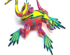 i like this frog/lizard animal becuase i like the bright colors. it  makes it stand out and isnt very ordinary. i also like the stripe going down its back. it adds a nice element to t he design.