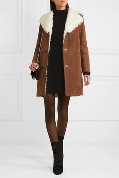 Brown suede, ivory shearling Button fastenings through front 100% suede (Goat); lining: 100% shearling Dry clean Made in Italy