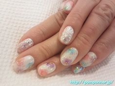 I have scattered your floral design and soft blue, purple, pink on white base.  I put glitter lame to the point of the right and left one by one.  It is spring nail colors bright.