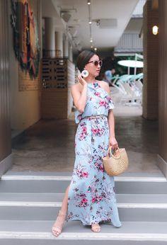 Extra Petite. Ligt blue floral halter maxi dess+nude ankle strap heeled sandals+raffia basket-bag+earrings+taupe belt+sunglasses. Summer Wedding Guest or Semiformal Event Outfit 2017
