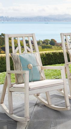Rock the day away in our Swedish-inspired, exclusive Elsa Rocker. Sleek design includes a tapered back, diagonals on the vertical slats, and a whimsical, yet unexpected triangle to the bottom back of the rocking chair.