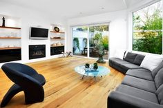 Furniture - Amazing Contemporary Living Room With Grey Big Sofas Design And Round Glass Coffee Table And Modern Black Chair On Wooden Floor: Amazing Big Sofas Design Ideas For Your Wide Rooms