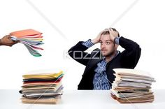 businessman over loaded with work. - Businessman over loaded with work over white background, Model: Adam Mirani